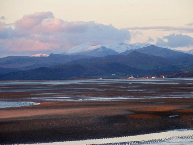 The Scafell range in the background behind the Duddon fells and estuary