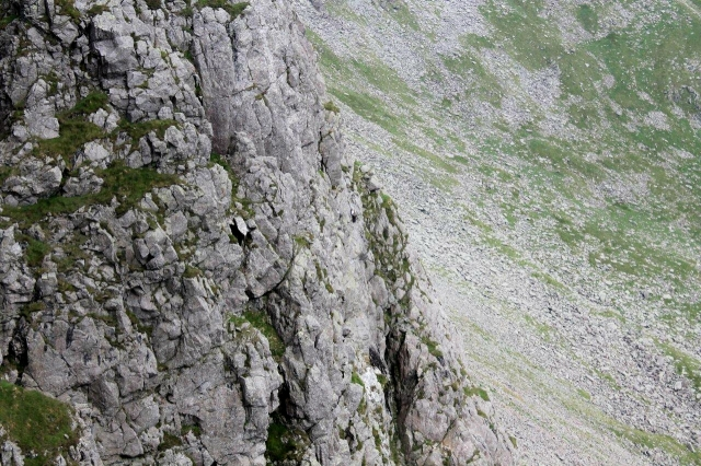 There's a climber on this picture. Can you see him?