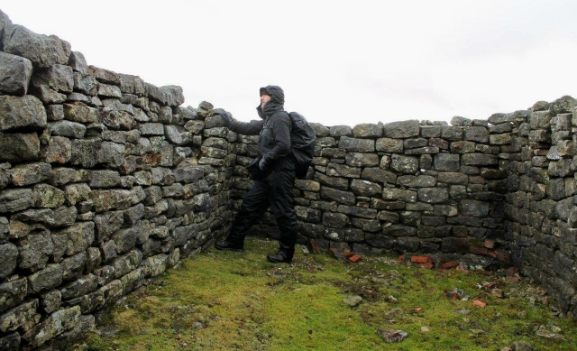 The walls of a ruined smithy high in the Hungry Hushes