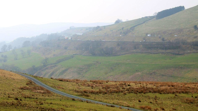 Fairmile Road is in the foreground, with the West Coast Main Line and M6 motorway on the far side of the Tebay Gorge. The River Lune flows through the gorge but you can't see it