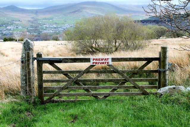Is there a need for a sign like this? What possible damage could a walker do if he or she took a course across this land?
